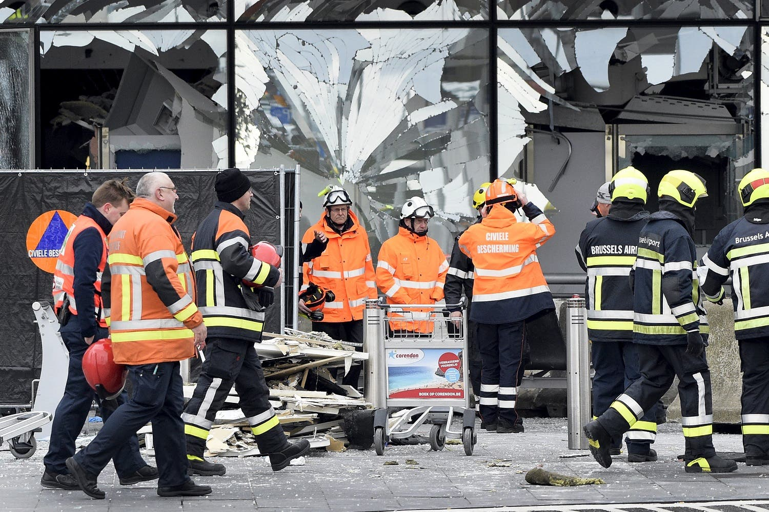 Broken windows of the terminal at Brussels national airport are seen during a ceremony following bomb attacks in Brussels metro and Belgium's National airport of Zaventem, Belgium, March 23, 2016. REUTERS