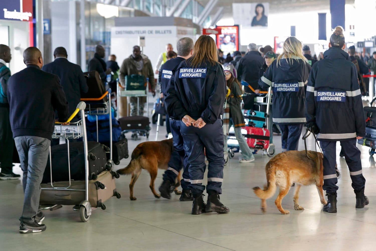 Members of airport security patrol inside the Charles de Gaulle International Airport in Roissy, near Paris, France, March 23, 2016 as France has decided to deploy 1,600 additional police officers to bolster security at its borders and on public transport following the bomb attacks in Brussels. REUTERS