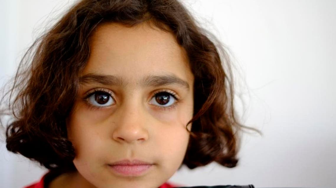 When the bombs started falling, Ismail grabbed his oldest daughter Alaa, who has trouble walking because of a congenital back problem, and ran out in the street for fear that their home would be hit (AP)