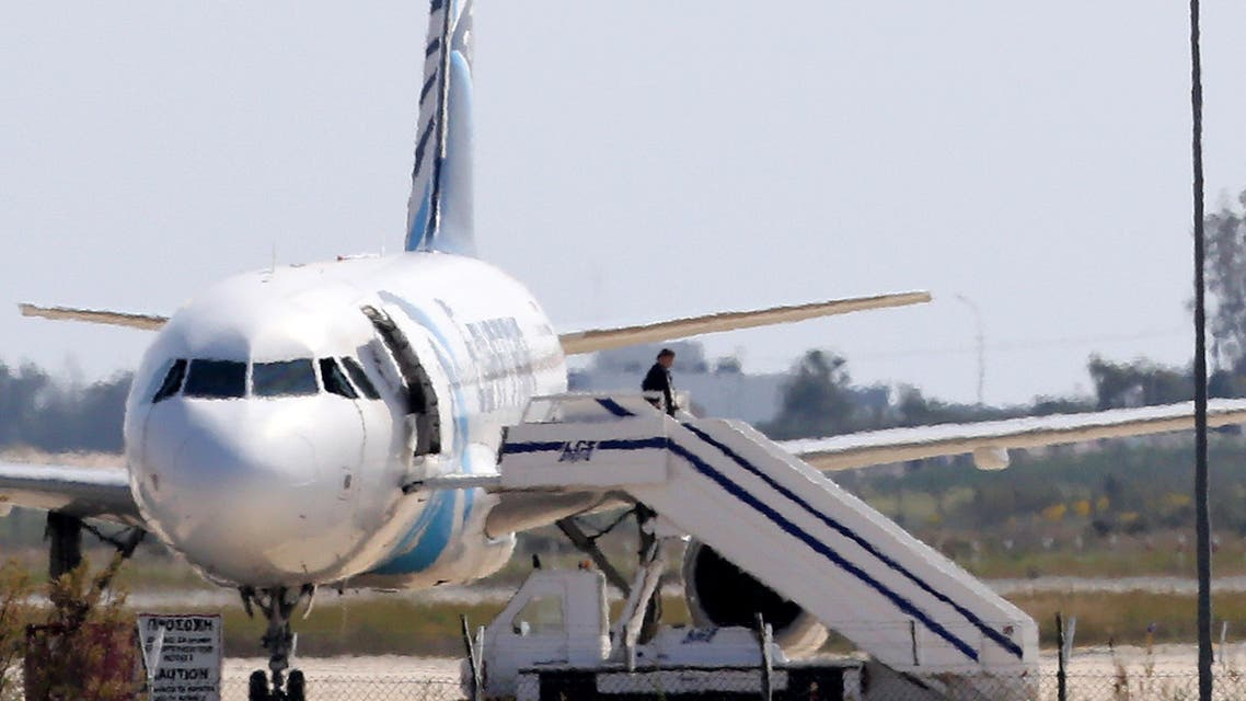 A man leaves the hijacked aircraft of Egyptair at Larnaca airport in Cyprus Tuesday, March 29, 2016. ِAP