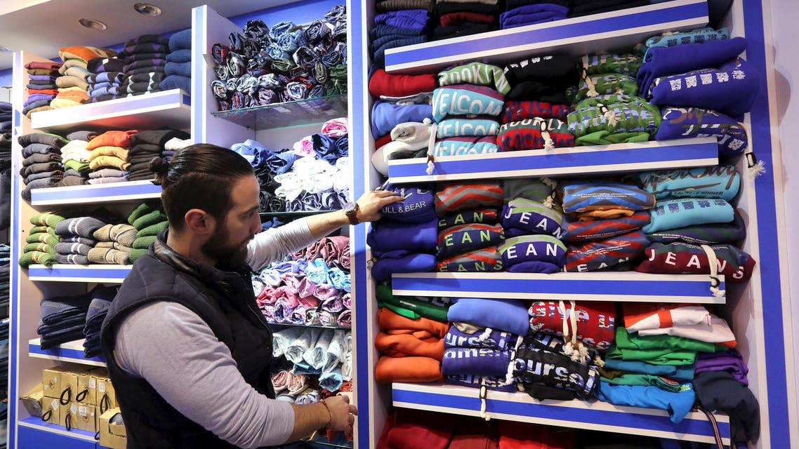A Syrian man works at a clothes shop in an area called 6 October City in Giza, Egypt, March 19, 2016.  (Reuters)
