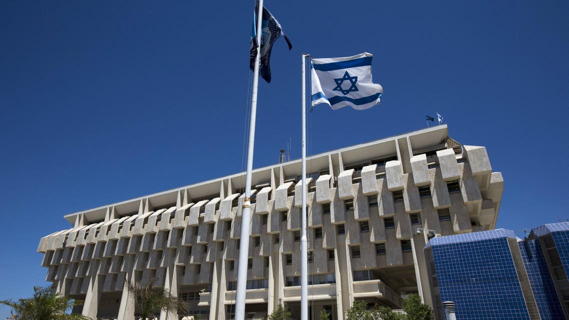 An Israeli flag flutters outside the Bank of Israel building in Jerusalem in this August 7, 2013 file photo. REUTERS/Ronen Zvulun/Files GLOBAL BUSINESS WEEK AHEAD PACKAGE - SEARCH 'BUSINESS WEEK AHEAD MARCH 28' FOR ALL IMAGES