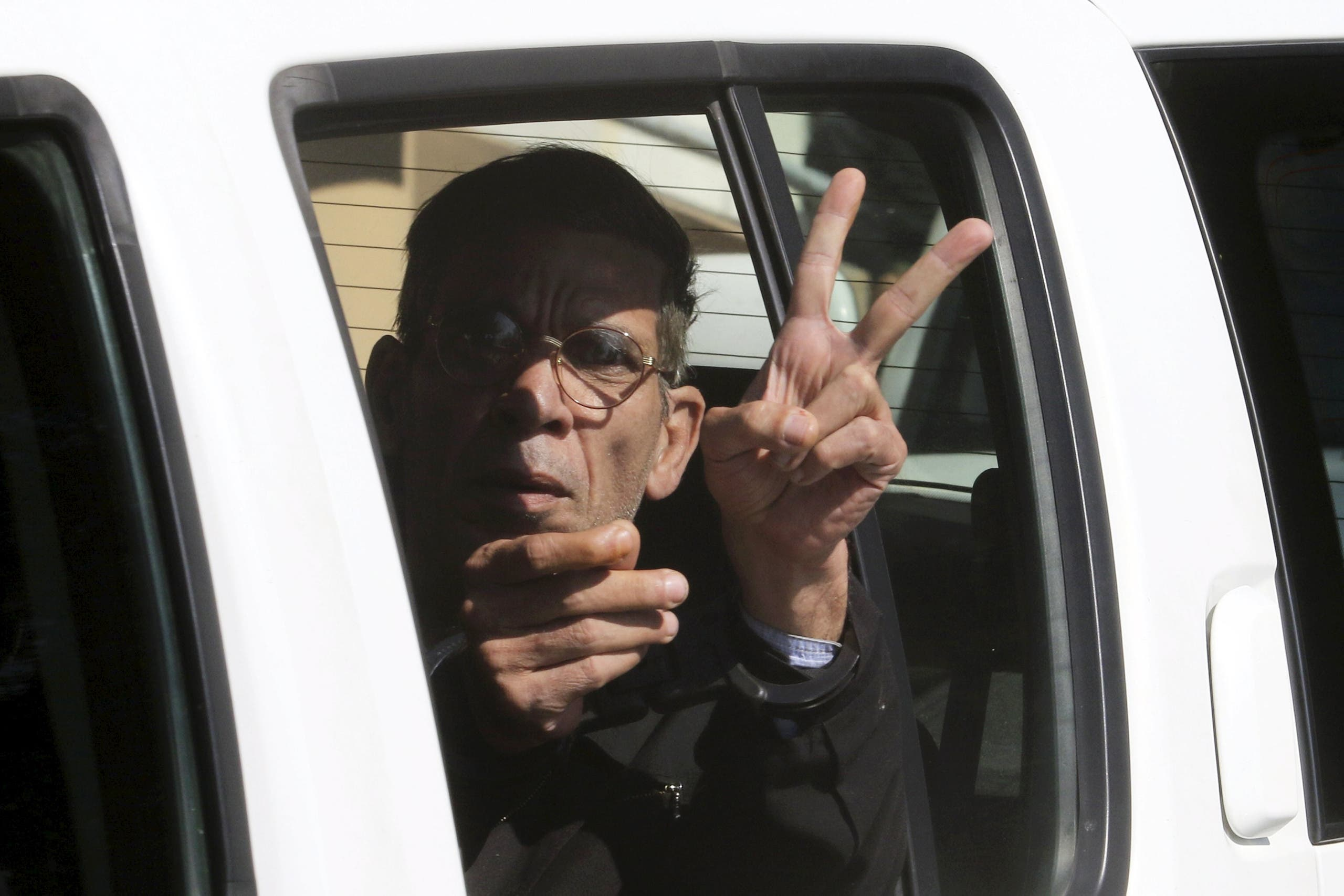 The man who was arrested after he hijacked an EgyptAir flight, which was forced to land in Cyprus on Tuesday, gestures as he is transferred by Cypriot police from a court in the city of Larnaca, Cyprus March 30, 2016 REUTERS