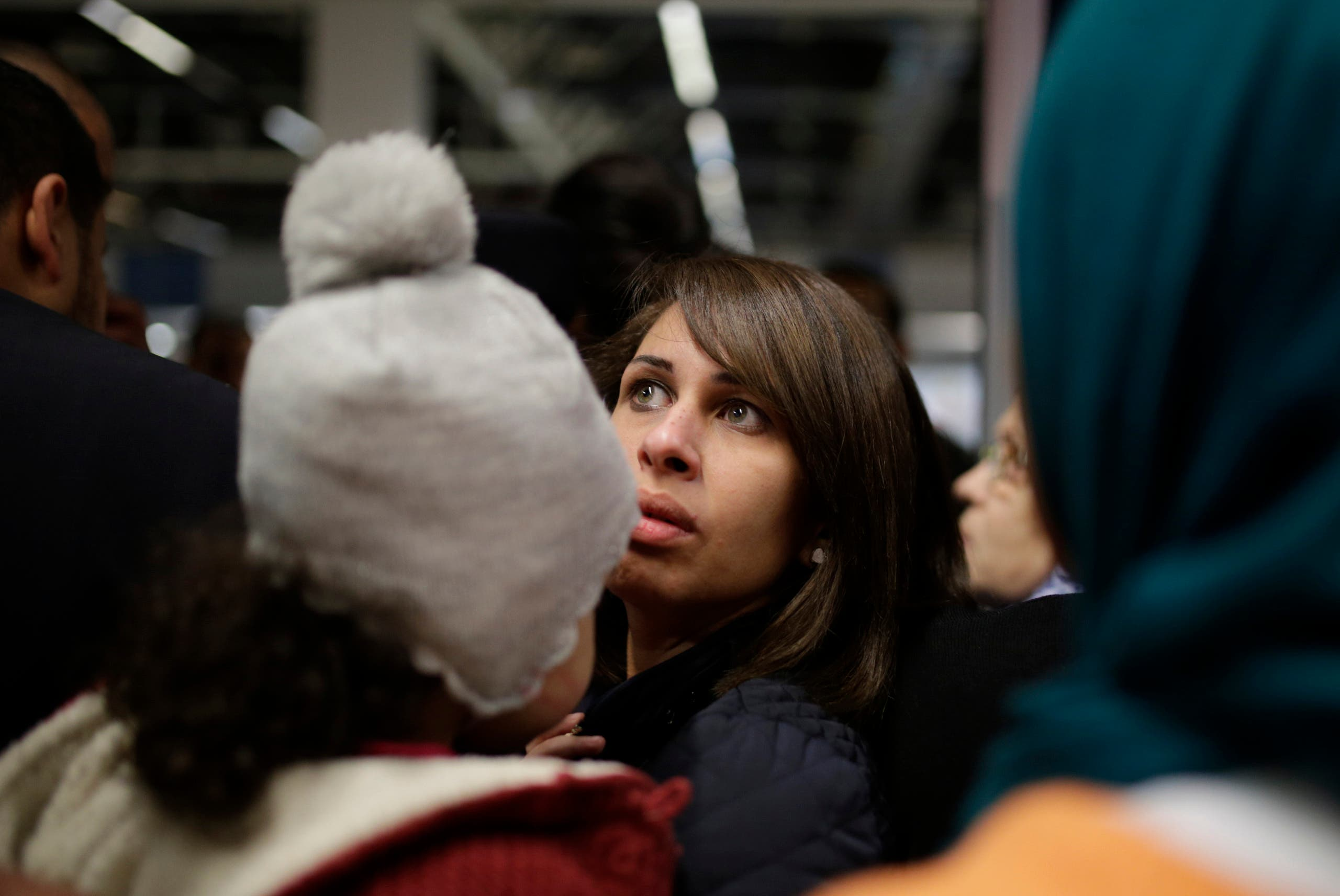 Relatives of passengers of the hijacked domestic EgyptAir flight, wait for their arrival at Cairo International airport, Egypt, Tuesday, March 29, 2016. (AP)
