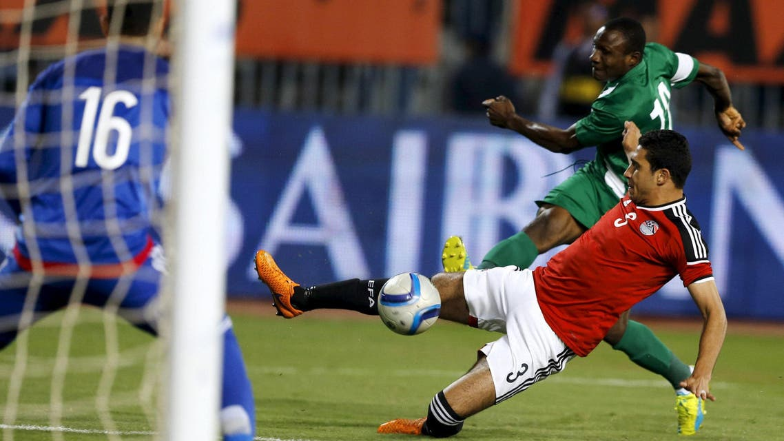 Egypt's Rami Rabia and Nigeria's Aminu Umar in action. REUTERS