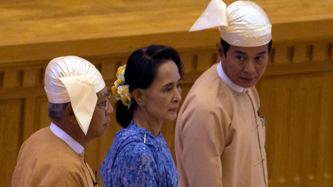 Htin Kyaw, left, newly elected president of Myanmar walks with National League for Democracy party leader Aung San Suu Kyi, center, to attend the sworn-in ceremony at parliament in Naypyitaw, Myanmar, Wednesday, March 30, 2016. (AP)