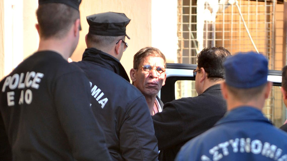 Cyprus police officers escort Egyptian Seif Eddin Mustafa, center, who hijacked an EgyptAir jetliner Tuesday to a court for a remand hearing in the Cypriot coastal town of Larnaca Wednesday, March 30, 2016. (AP)