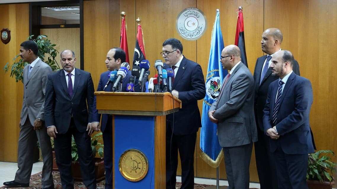 Fayez Al-Sarraj, flanked by members of the Presidential Council, speaks during a news conference at the Mitiga Naval Base in Tripoli, Libya, Wednesday, March, 30, 2015. AP