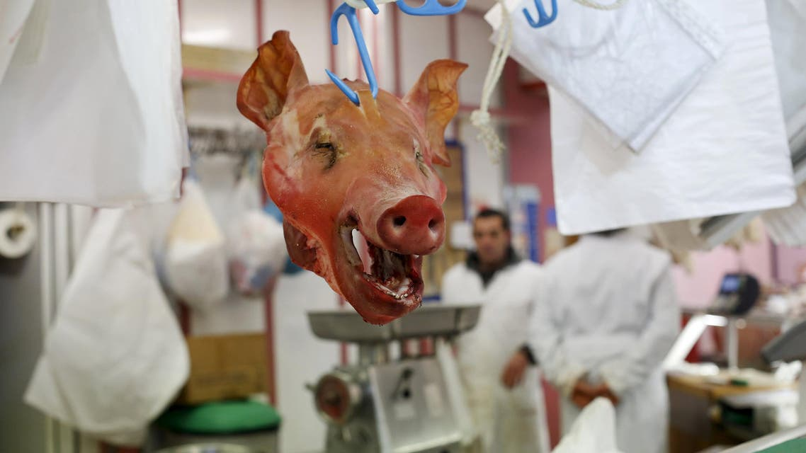 A pig's head is seen in a butcher's shop in the central market in Florence, Italy in this March 1, 2016 file photo. REUTERS