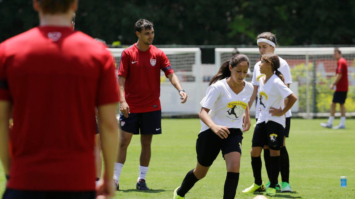 """Young female players take part in a program coined """"Sports for All"""" organized by the US Consulate which gives public school kids soccer and English lessons, with the U.S. national soccer team in Sao Paulo, Brazil, Wednesday, Jan. 22, 2014. AP"""