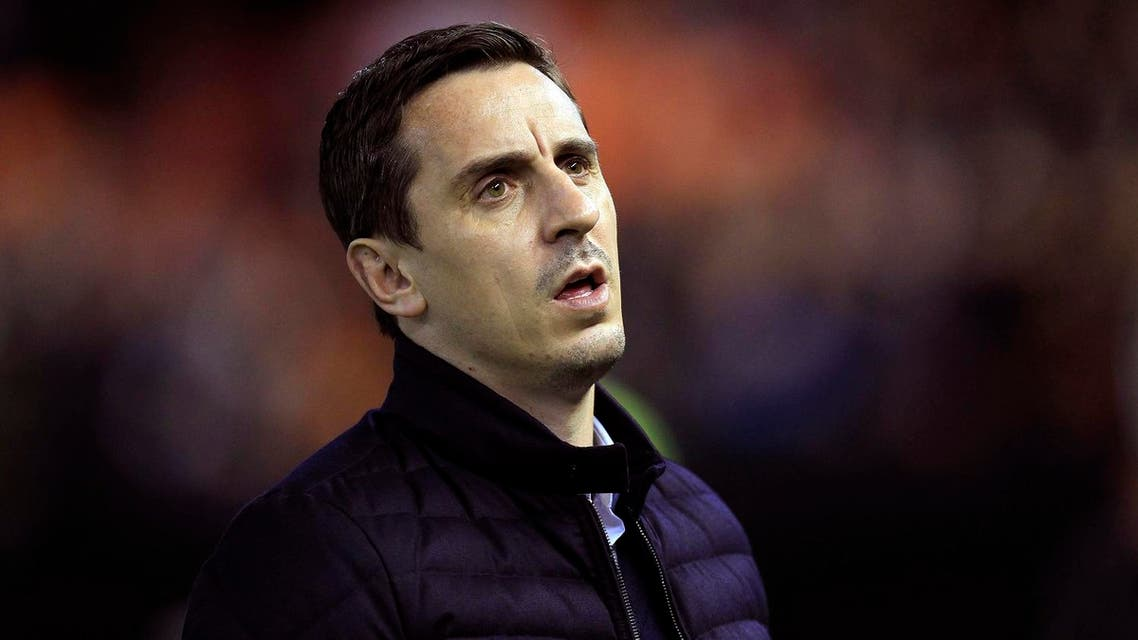 In this Sunday, Jan. 3, 2016 file photo, Valencia's head coach Gary Neville arrives for a Spanish La Liga soccer match against Real Madrid at the Mestalla stadium in Valencia, Spain. Gary Neville knew that coaching at a high level wasn't going to be easy. AP