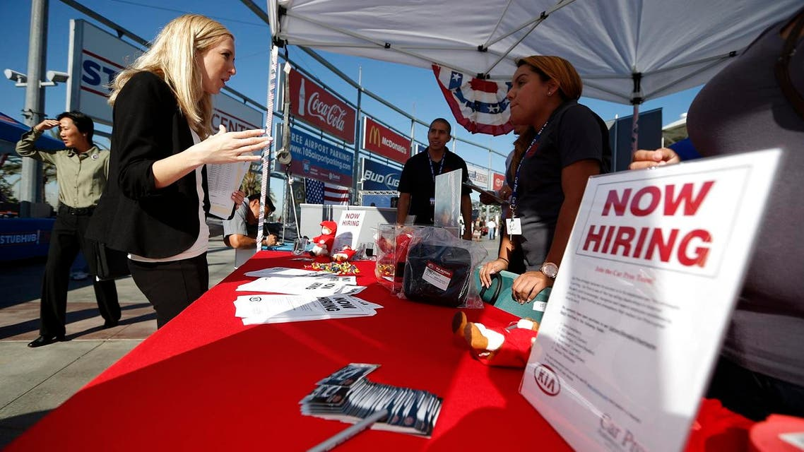 People browse booths at a military veterans' job fair in Carson, California, in this file photo taken October 3, 2014. U.S. employment gains surged in February, the clearest sign yet of labor market strength that could further ease fears the economy was heading into recession and allow the Federal Reserve to gradually raise interest rates this year. REUTERS