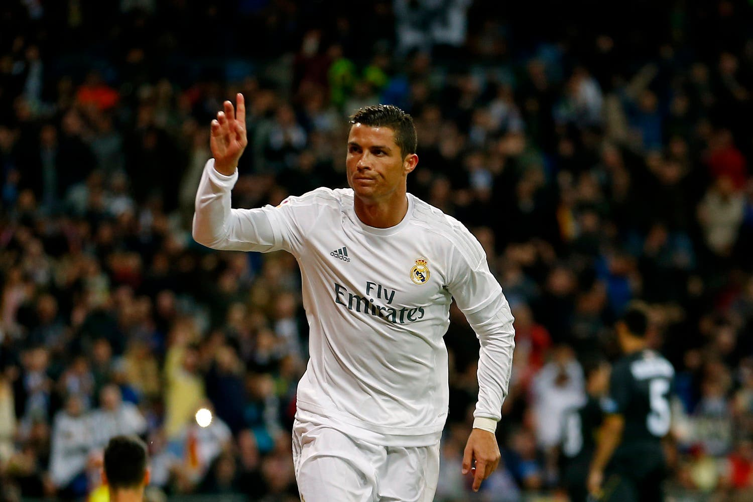 Real Madrid's Cristiano Ronaldo celebrates after scoring against Sevilla during a Spanish La Liga soccer match between Real Madrid and Sevilla at the Santiago Bernabeu stadium, in Madrid, Sunday, March 20, 2016. Ronaldo scored once in Real Madrid's 4-0 victory. (AP)