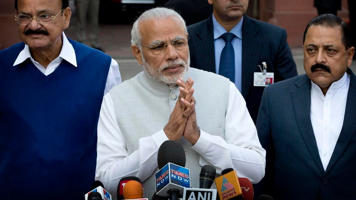 Indian Prime Minister Narendra Modi, center, with his cabinet colleagues greet the media as he arrives on the opening day of budget session of the Indian parliament in New Delhi, India, Tuesday, Feb. 23, 2016. The budget session of the parliament which focus largely on the financial business of the government began Tuesday and the Union Budget will be presented on Feb. 29. (AP)