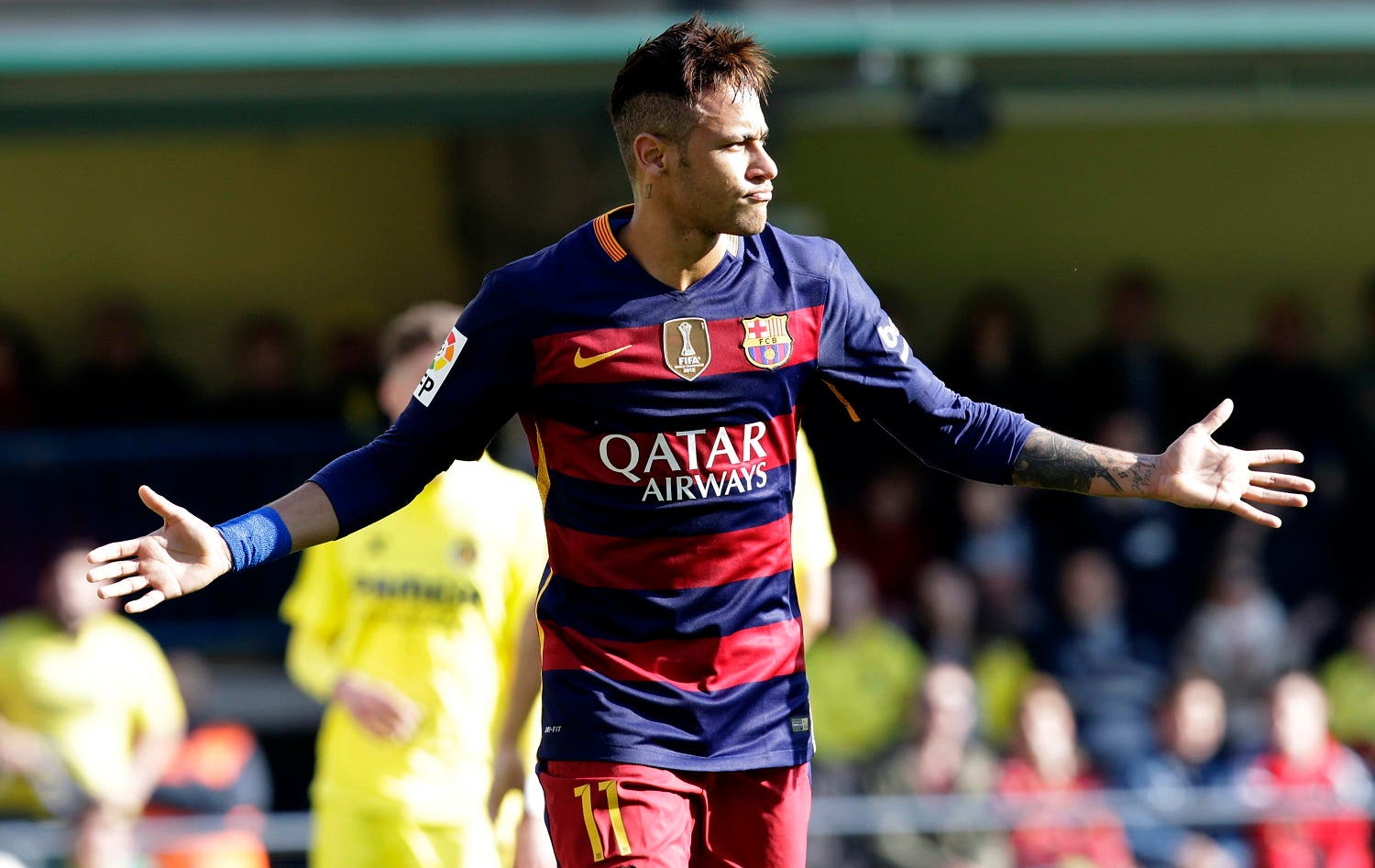 Barcelona's Neymar celebrates after scoring during the Spanish La Liga soccer match between Villarreal and Barcelona at the Madrigal stadium in Villarreal, Spain, Sunday, March 20, 2016. (AP)