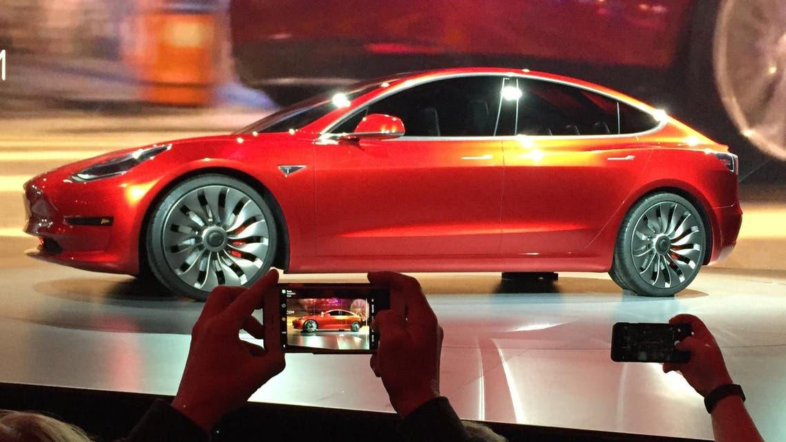 Tesla Motors unveils the new lower-priced Model 3 sedan at the Tesla Motors design studio in Hawthorne, Calif., Thursday, March 31, 2016 (AP)