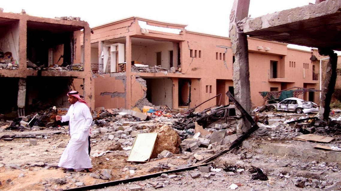 A Saudi security man walks in front of a damaged building after an al-Qaeda suicide attack on a compound used by expatriates in Riyadh May 13, 2003. (File photo: Reuters)