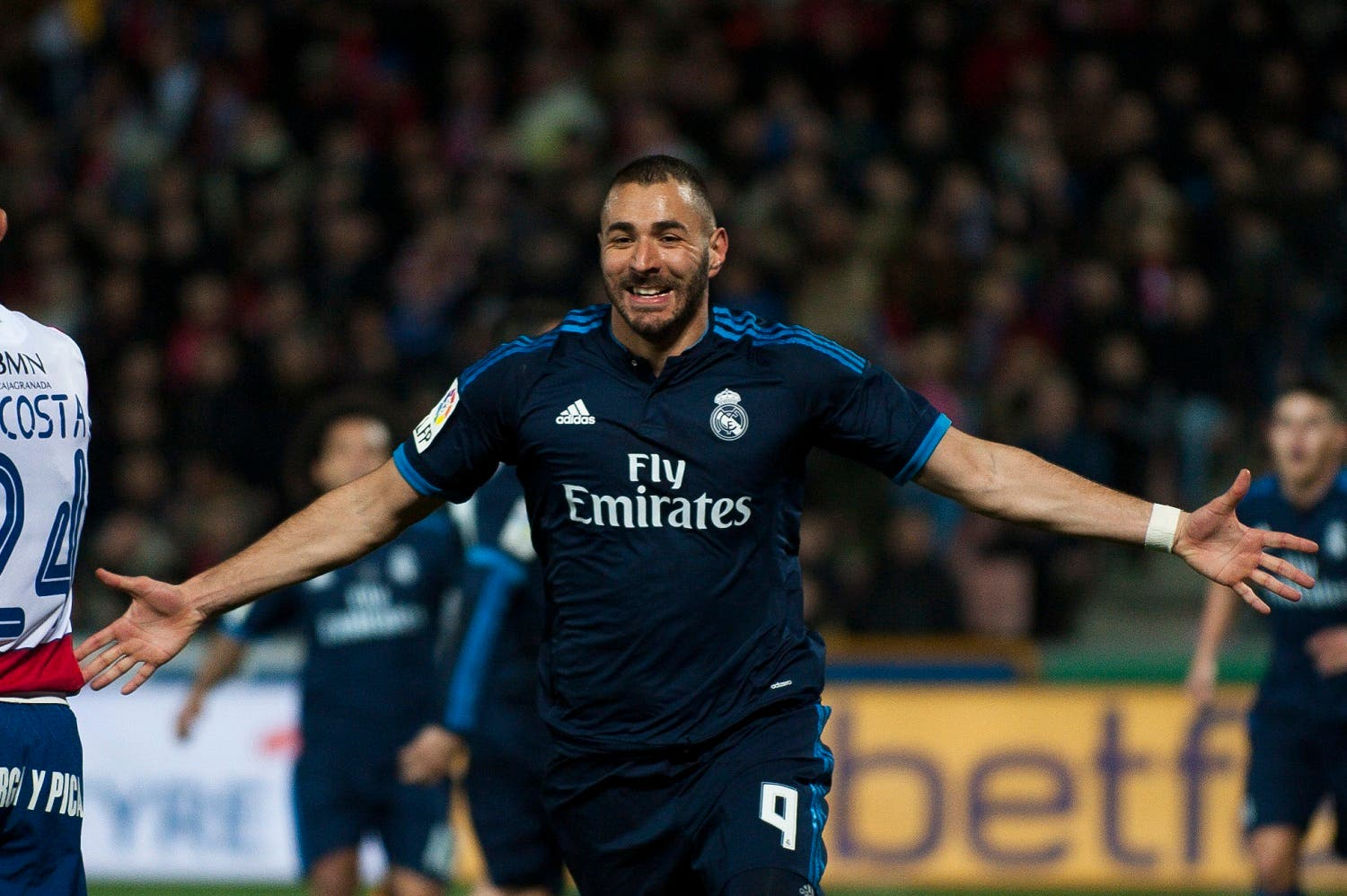 Real Madrid 's Karim Benzema celebrates his goal during a Spanish La Liga soccer match between Granada and Real Madrid at Los Carmenes stadium in Granada, Spain, Sunday, Feb. 7, 2016. (AP)