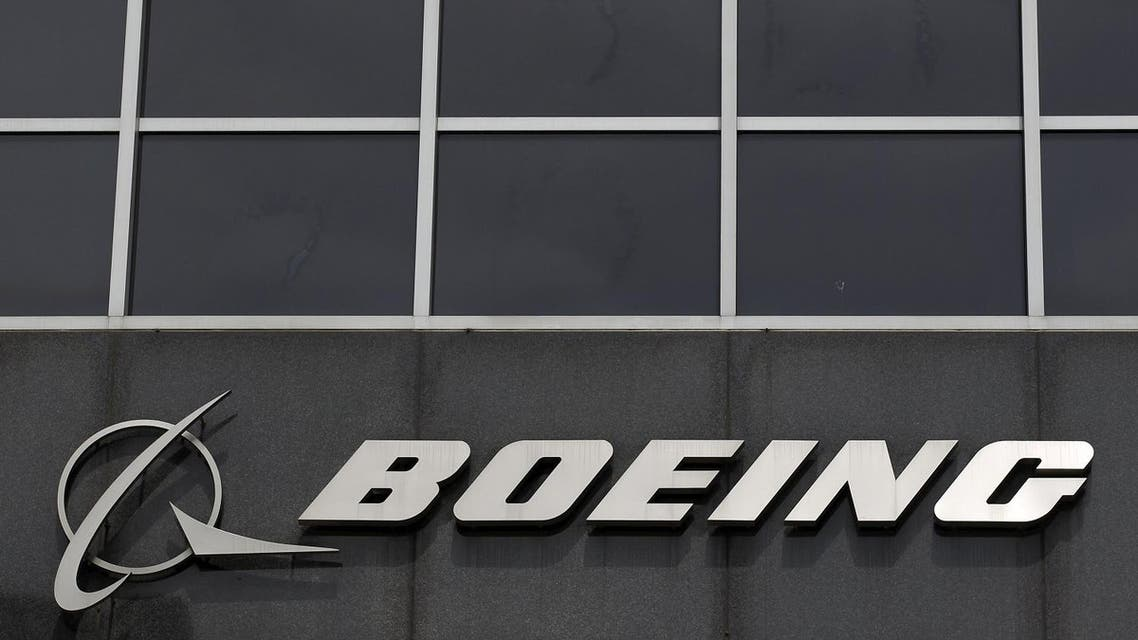 The Boeing logo is seen at their headquarters in Chicago, in this April 24, 2013 file photo. Boeing Co plans to cut up to 8,000 jobs this year at its commercial airplane division, according to two people familiar with the matter, a move that could slash $1 billion in costs and help it battle for sales against European rival Airbus. Boeing on March 30, 2016 acknowledged plans to cut about 4,000 jobs in its commercial airplanes division by mid-year, and another 550 jobs in a unit that conducts flight and lab testing. REUTERS