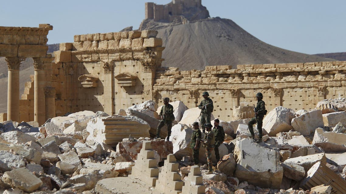 Syrian army soldiers stands on the ruins of the Temple of Bel in the historic city of Palmyra, in Homs Governorate, Syria in this April 1, 2016 file photo. (reuters)