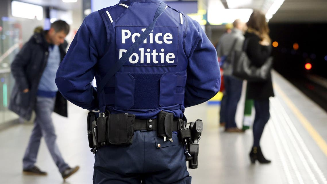 A Belgian police officer patrols in a metro station, a week after bomb attacks in a Brussels metro station and the Belgian international airport of Zaventem, in Brussels, Belgium, March 29, 2016.  (Reuters)