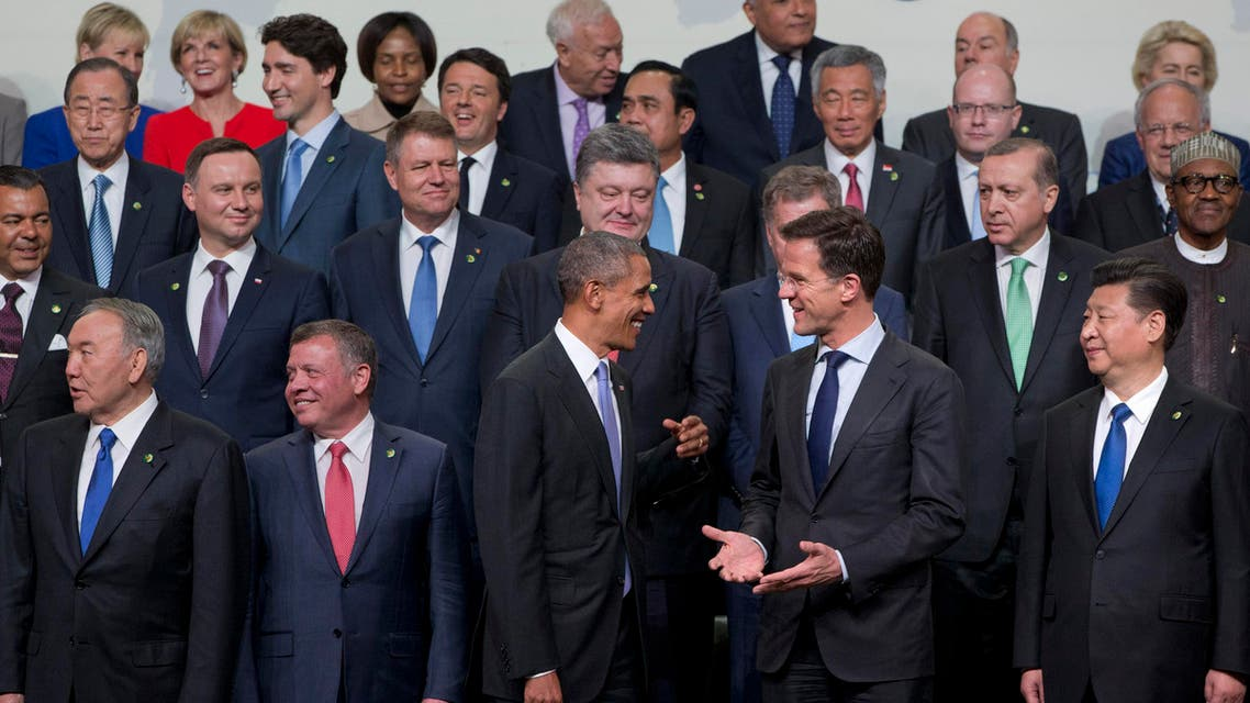 """President Barack Obama chats with Dutch Prime Minister Mark Rutte, next to Chinese President Xi Jinping , as they arrive for a """"family photo"""" with world leaders attending the Nuclear Security Summit in Washington, Friday, April 1, 2016. (AP)"""