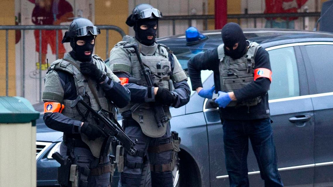 Special operations police secure an area during a police raid in the Molenbeek neighbourhood of Brussels, Belgium on Friday, March 18, 2016. Two French police officials have told The Associated Press that Salah Abdeslam, the main fugitive from Islamic extremist attacks in Paris in November, has been arrested in Belgium's capital after four months at large. He was arrested Friday in a major police operation in the Brussels neighborhood of Molenbeek. (AP)