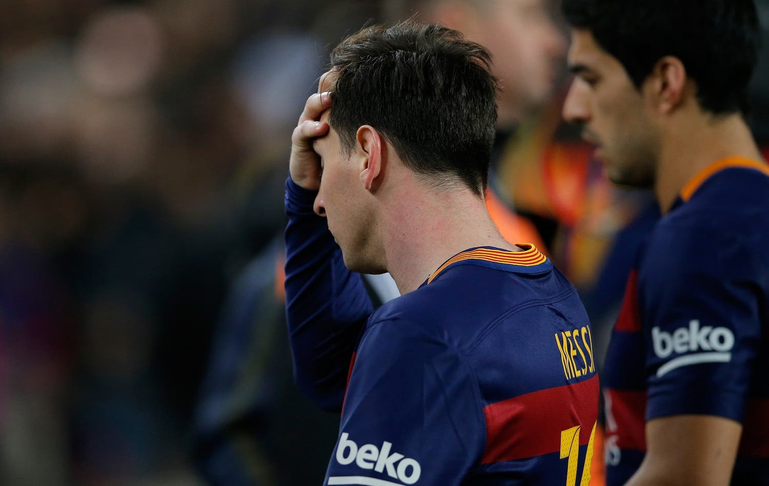 Barcelona's Lionel Messi and Luis Suarez, right, leave the pitch at the end of a Spanish La Liga soccer match between Barcelona and Real Madrid, dubbed 'el clasico', at the Camp Nou stadium in Barcelona, Spain, Saturday, April 2, 2016. Real Madrid won 2-1. (AP)