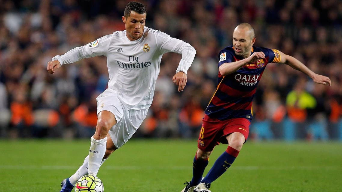Real Madrid's Cristiano Ronaldo, left, drives the ball past Barcelona's Andres Iniesta during a Spanish La Liga soccer match between Barcelona and Real Madrid, dubbed 'el clasico', at the Camp Nou stadium in Barcelona, Spain, Saturday, April 2, 2016. (AP)