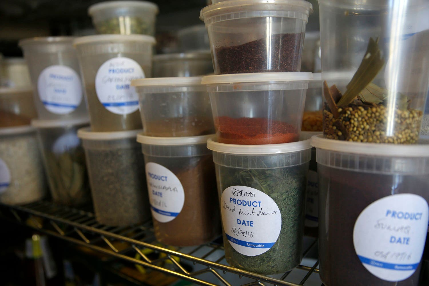 Spices from around world are stocked in the Eat Offbeat pantry in New York, Tuesday, March 29, 2016. A food delivery service is offering New Yorkers the chance to try some food cooked by some unusual chefs. All seven employees at Eat Offbeat are either refugees or asylum-seekers who fled their home countries. They're cooking foods from those places, including Iraq and Nepal. (AP)