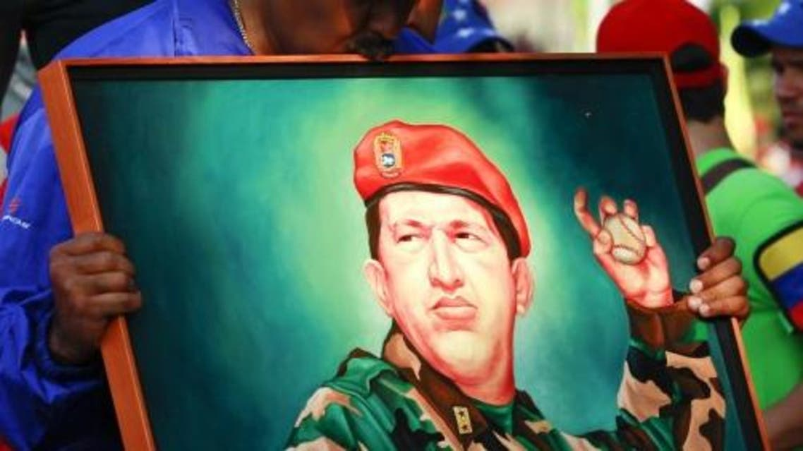 Venezuela's acting President and presidential candidate Nicolas Maduro kisses a painting of late Venezuelan president Hugo Chavez during a campaign rally in the state of Vargas April 9, 2013. (Reuters)