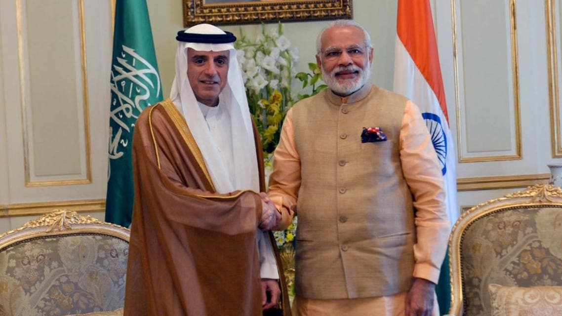 India's Prime Minister Narendra Modi (R) shakes hands with Saudi Arabia's Foreign Minister Adel al-Jubeir during their meeting in Riyadh. (Reuters)