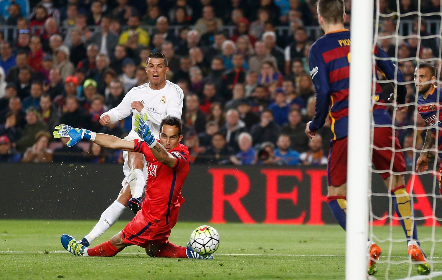 Real Madrid's Cristiano Ronaldo, left, scores his side's second goal past Barcelona goalkeeper Claudio Bravo during a Spanish La Liga soccer match between Barcelona and Real Madrid, dubbed 'el clasico', at the Camp Nou stadium in Barcelona, Spain, Saturday, April 2, 2016. (AP)