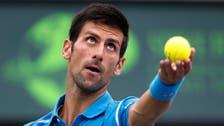 Djokovic says Federer's slam record 'in back of my mind'