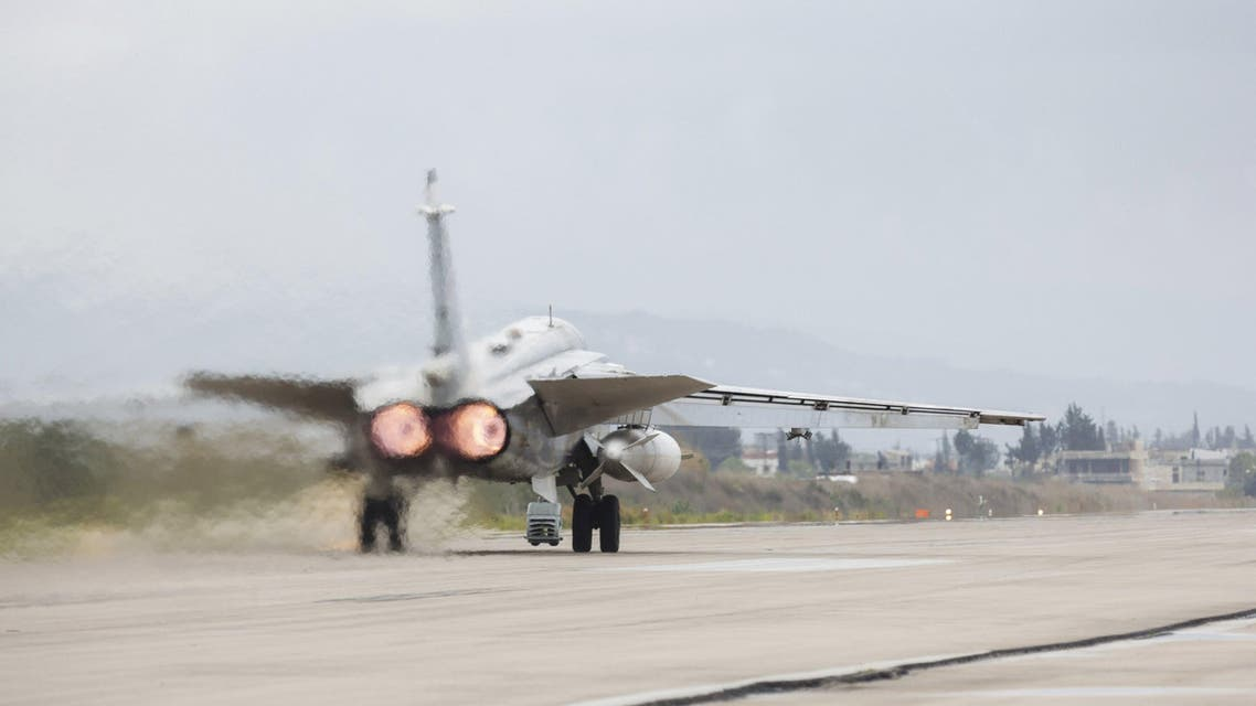 A Russian military jet is seen on a runway before taking off during the withdrawal of Russian troops from Syria at Hmeymim airbase, Syria, March 16, 2016.
