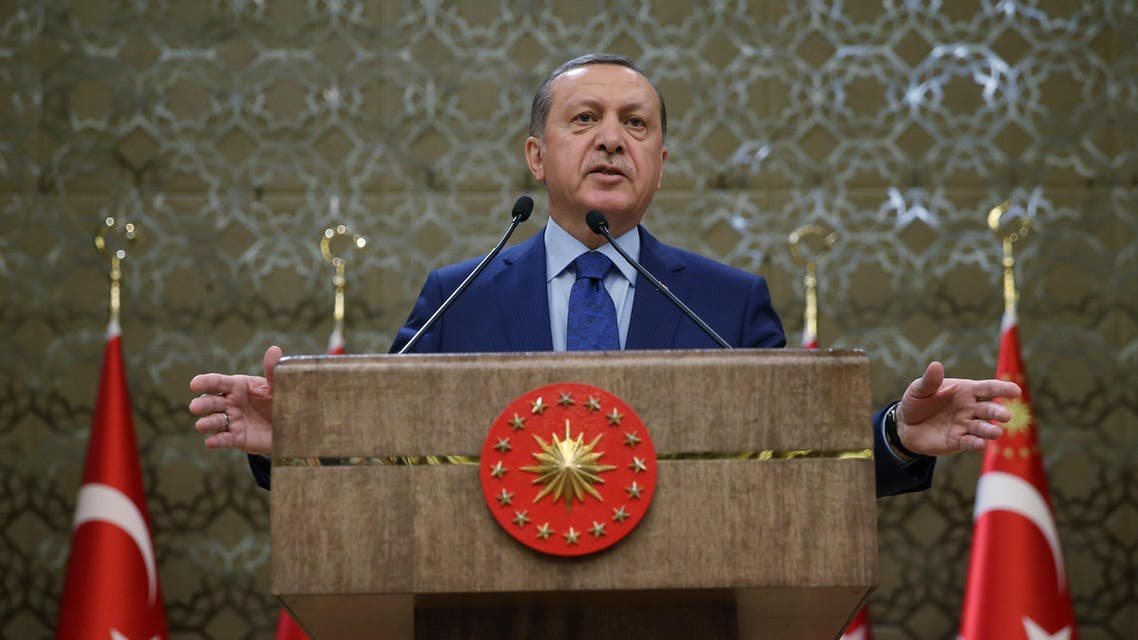 Turkish President Recep Tayyip Erdogan addresses a meeting of local administrators at his palace in Ankara, Turkey, Wednesday, March 16, 2016. Tayyip Erdogan says US and Russian weapons are ending up in the hands of the Kurdistan workers' Party, or PKK, which his country considers a terrorist organization. (Murat Cetinmuhurdar, Pool)