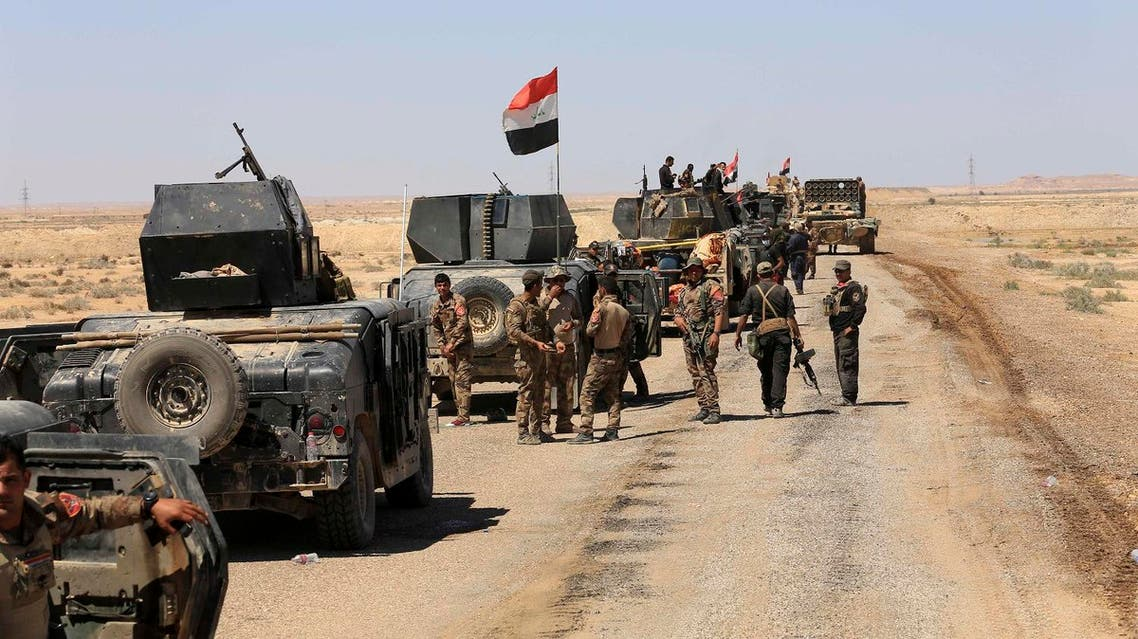 Iraqi security forces prepare to attack Islamic State group positions in Hit, 85 miles (140 kilometers) west of Baghdad, Iraq, Saturday, April 2, 2016. The United Nations mission to Iraq said in a statement Friday that violence killed at least 1,119 Iraqis in March, a sharp increase from the previous month, as the Islamic State group stepped up attacks on civilians despite suffering battlefield setbacks. (AP)
