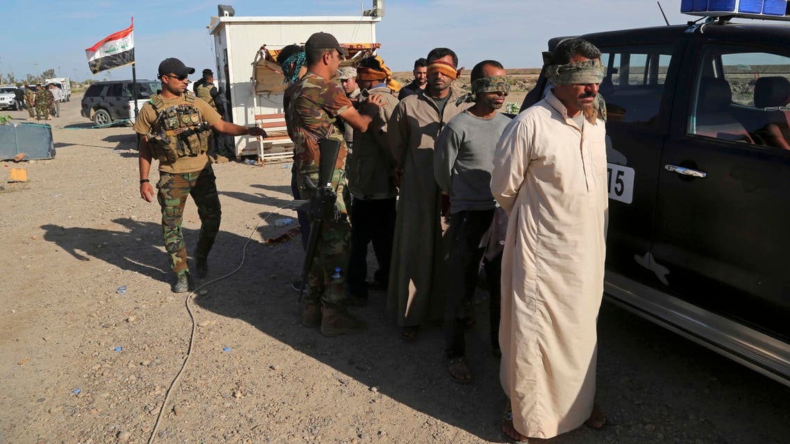 Iraqi security forces detain suspected members of the Islamic State group for interrogation after the men were found among civilians returning to Ramadi for the first time since the city was taken back by Iraqi government forces earlier this year, at a checkpoint in Ramadi, Iraq, Sunday, April 3, 2016. (AP)