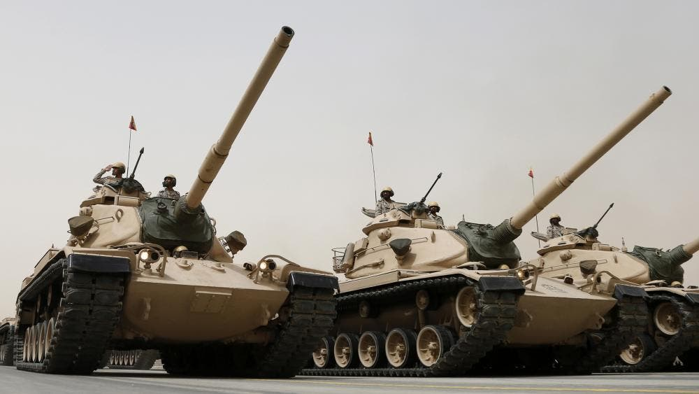 Tanks roll during Saudi security forces' Abdullah's Sword military drill in Hafar Al-Batin, near the border with Kuwait April 29, 2014. (Reuters)