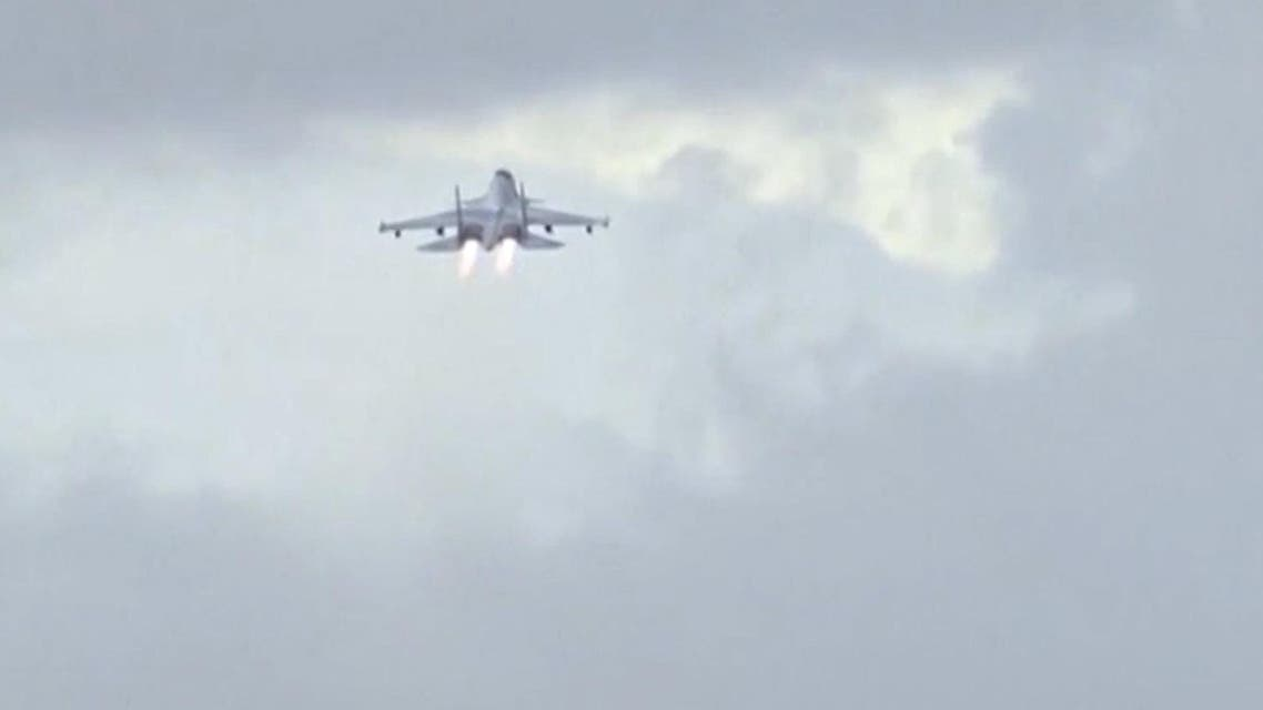 A Russian military jet takes off from the country's air base in Hmeymin, Syria, to head back to Russia, part of a partial withdrawal ordered by President Vladimir Putin, in this still image taken from video shot on March 15, 2016. reuters