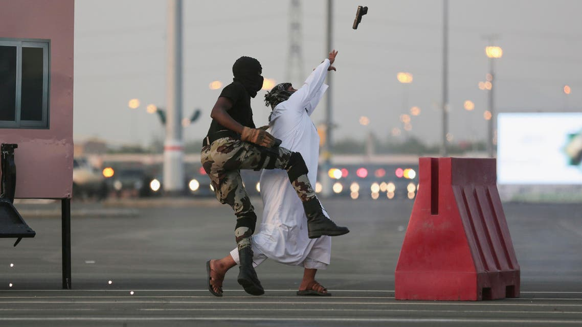 In this Thursday, Sept. 17, 2015 file photo, Saudi security forces show their skills to handle a terrorist attack as they take part in a military parade AP