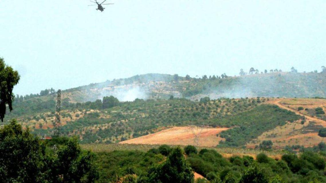 An army helicopter flies over an area where the military is fighting armed Islamists, east of Algiers (AFP Photo/)
