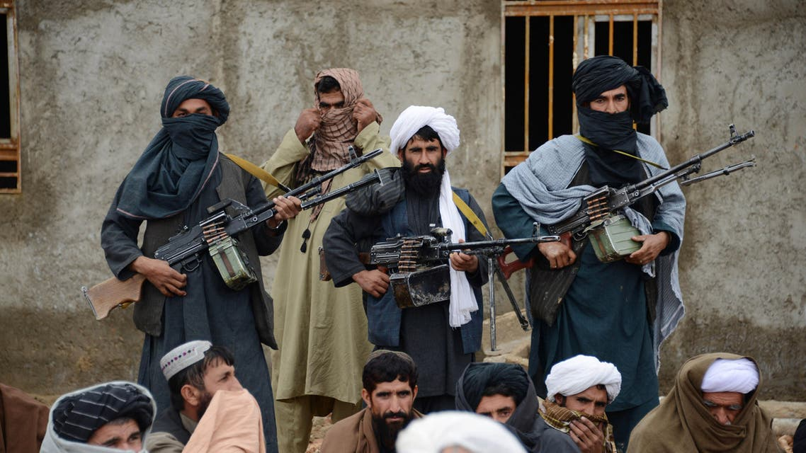 In this Tuesday, Nov. 3, 2015 file photo, Afghan Taliban fighters listen to Mullah Mohammed Rasool, unseen, the newly-elected leader of a breakaway faction of the Taliban, in Farah province, Afghanistan.