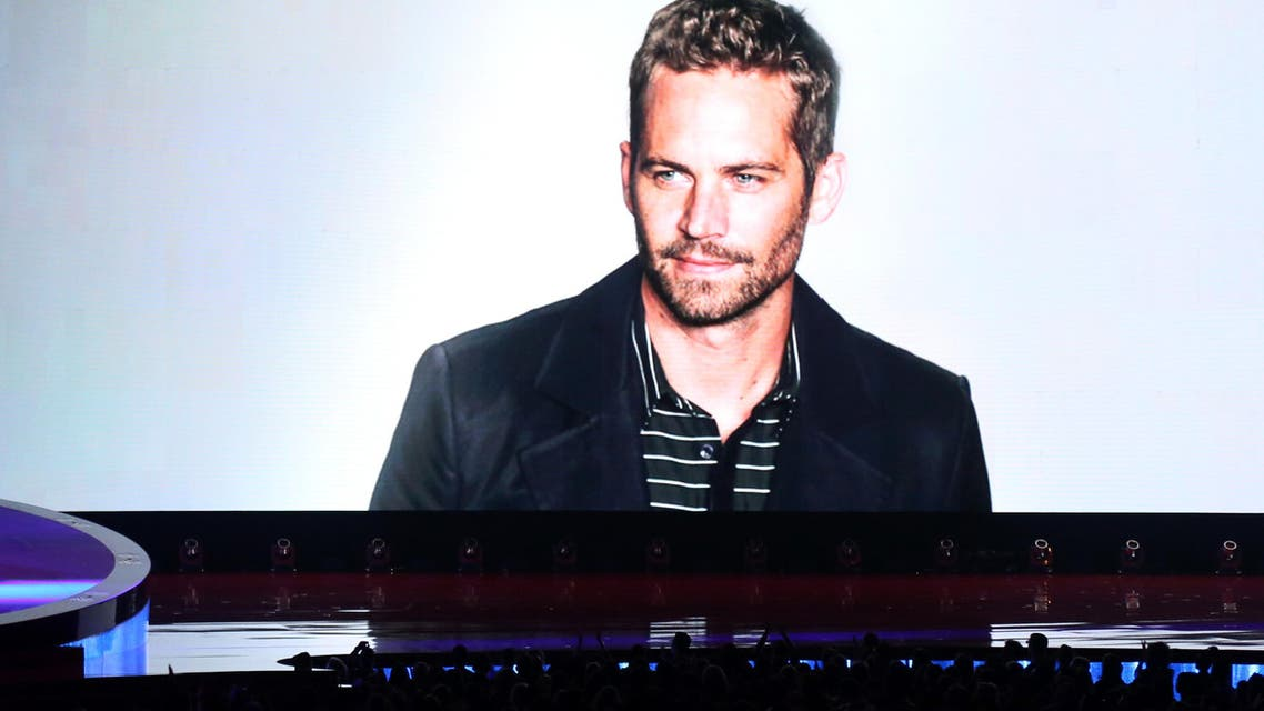 A tribute to Paul Walker is seen on screen at the MTV Movie Awards on Sunday, April 13, 2014. (AP)