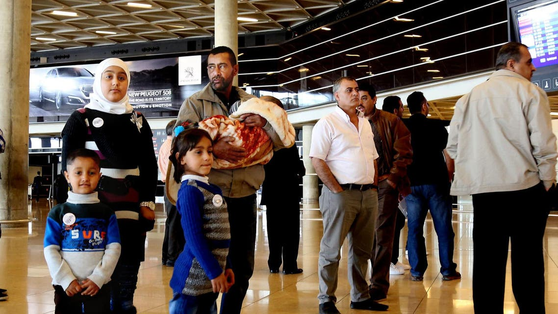 Syrian refugee Ahmad al-Abboud, center, waits with his family at the International Airport of Amman, Jordan, Wednesday, April 6, 2016. AP