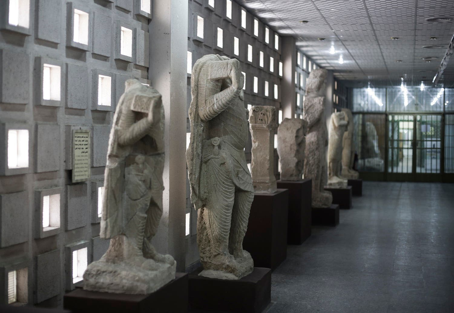 In this Sunday, March 13, 2016 photo, stone figures from the ancient site of Hatra line a corridor of the Iraq National Museum the Iraqi capital. (AP)