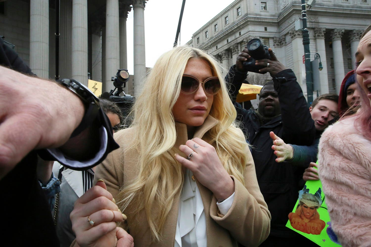 In this Feb. 19, 2016 file photo, pop star Kesha leaves Supreme court in New York after a hearing involving her producer, Dr. Luke. About 35 Kesha fans gathered outside Sony's Manhattan headquarters on Friday, March 11, to deliver petitions with more than 411,000 signatures demanding that the label release Kesha from her Sony recording contract and drop the producer, Dr. Luke, who she has accused of raping her. The hit-making producer, born Lukas Gottwald, is not charged with any crime. (AP)
