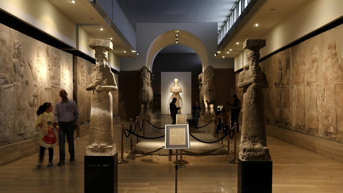 In this Monday, March 7, 2016 file photo, Iraqis visit the Assyrian Hall surrounded by ancient artifacts of at the Iraq National Museum in Baghdad. After the destruction wreaked on archaeological sites by Islamic State group, the collections at the Iraq's National Museum in Baghdad have become even more important. (AP)