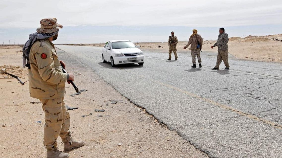 Libyan soldiers manning a military outpost, stop a car at a checkpoint in Wadi Bey, west of the city of Sirte, which is held by Islamic State militants, in this February 23, 2016 (Reuters)