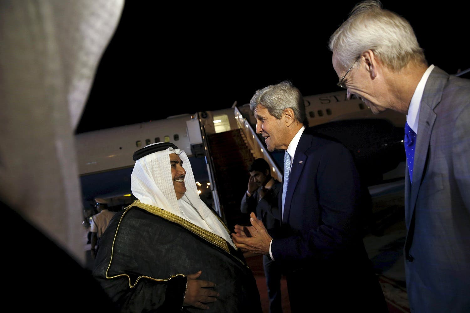 Bahrain's Foreign Minister Khalid bin Ahmed Al Khalifa (L) and U.S. Ambassador to Bahrain William Roebuck (R) greet US Secretary of State John Kerry. (Reuters)